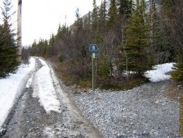 Hang a right on the trail that is to the right of this sign.