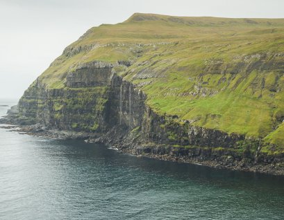 Impressive sea cliffs by Dalur