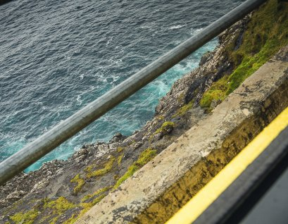 The guard rail skirts the cliffs ever so closely